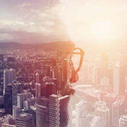 man_looking_at_city_smart_cities_Adobe_rt